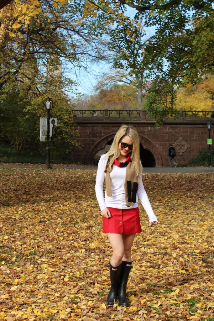 Caitlin Hartley of Styled American red skirt black hunter boots, girl walking in the leaves
