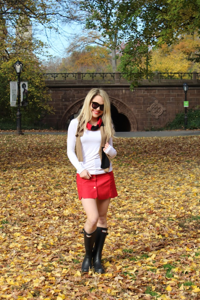 Caitlin Hartley of Styled American red skirt, black rain boots, preppy scarf