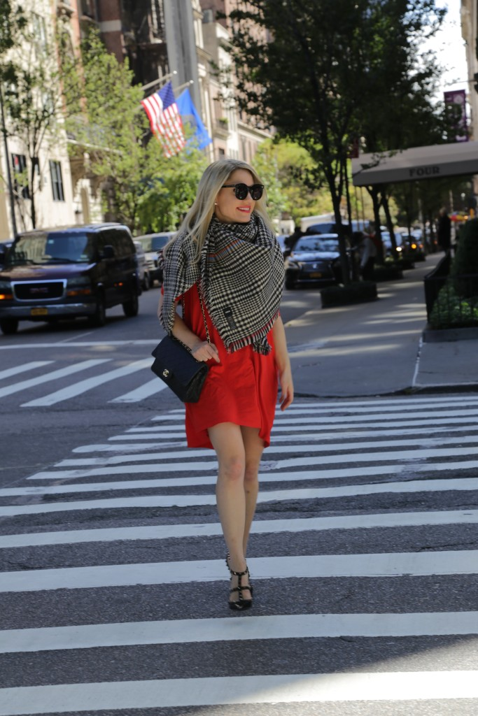 Caitlin Hartley of Styled American holiday outfit ideas, chanel bag, red dress, blanket scarf and black Valentino pumps