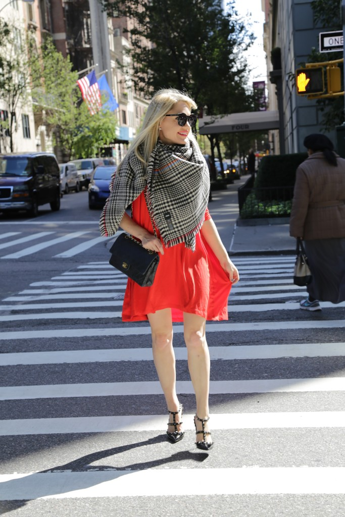 Caitlin Hartley of Styled American red dress with plaid blanket scarf