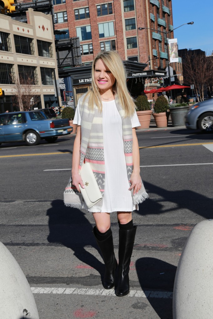 Caitlin Hartley of Styled American white tory burch clutch, black sam edelman boots