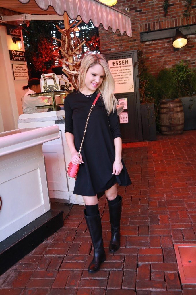 Caitlin Hartley of Styled American girl in asos black dress at a biergarten