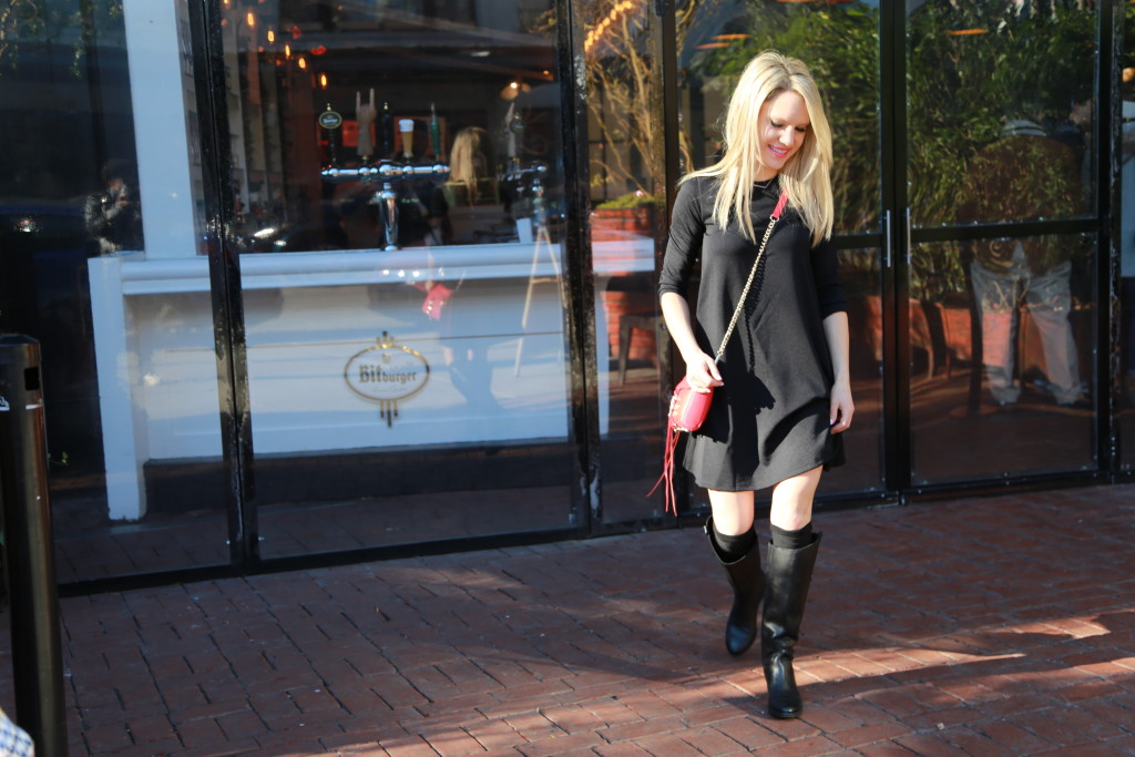 Caitlin Hartley of Styled American little black dress, red bag and black flat boots