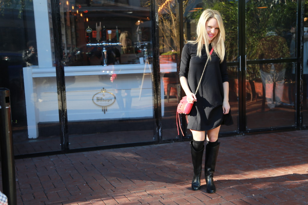 Caitlin Hartley of Styled American girl in black swing dress