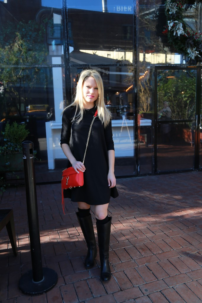 Caitlin Hartley of Styled American black shift dress, black flat boots and black boot socks