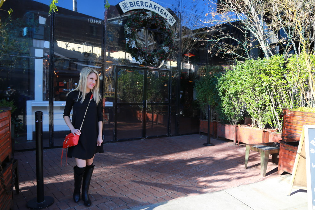 Caitlin Hartley of Styled American biergarten, girl in black dress and red cross-body bag