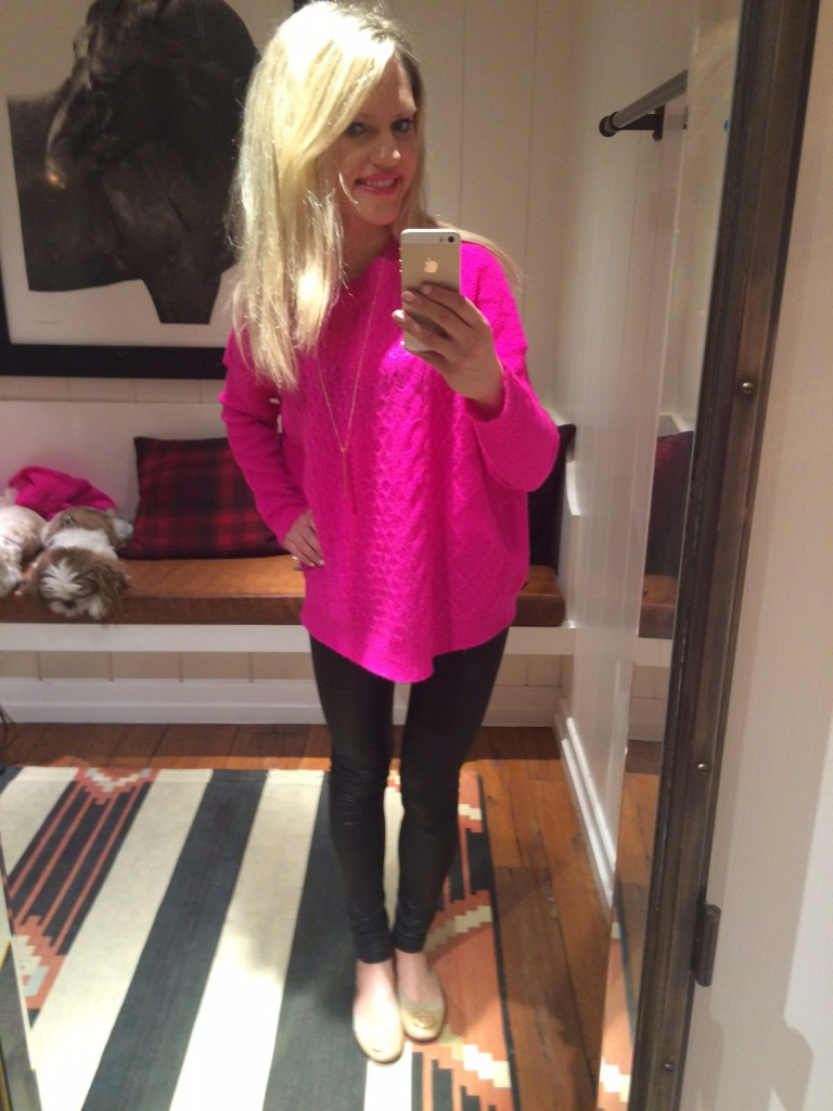 Caitlin Hartley of Styled American trying on sweaters at Ralph Lauren