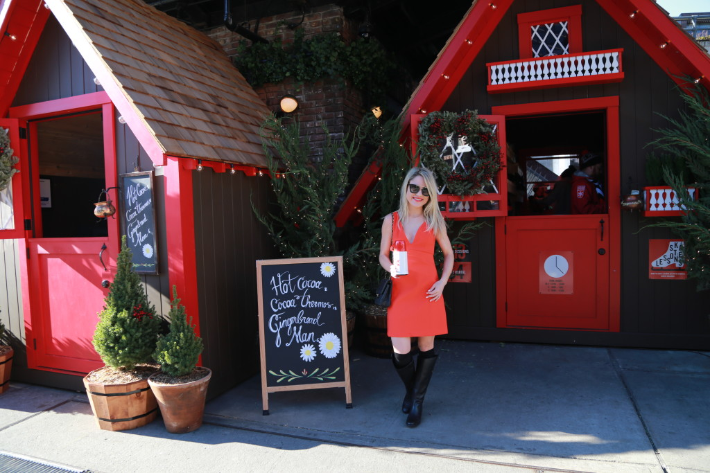 Caitlin Hartley of Styled American deep-v red dress, black flat boots