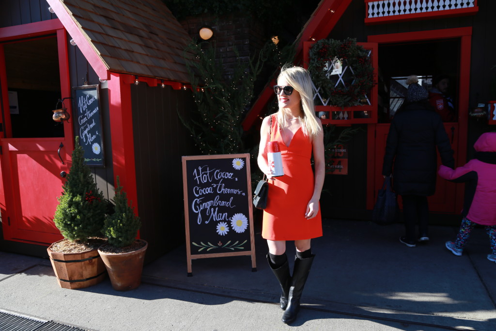 Caitlin Hartley of Styled American girl in red dress holding hot chocolate