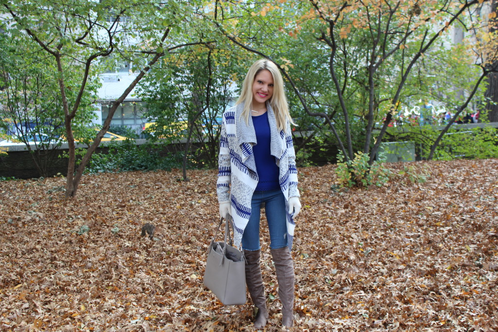 Caitlin Hartley of Styled American royal blue work top, blue and white long cardigan