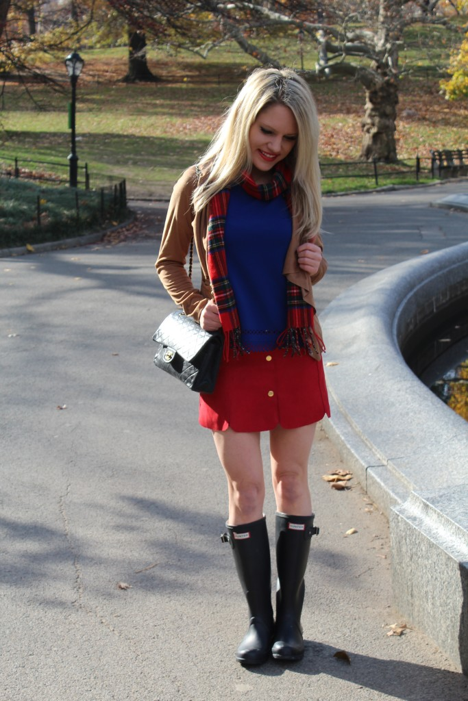 Caitlin Hartley of Styled American royal blue top, red mini skirt, Hunter rain boots