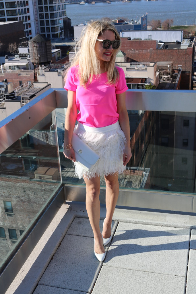 Caitlin Hartley of Styled American feather white skirt, hot pink top, white clutch