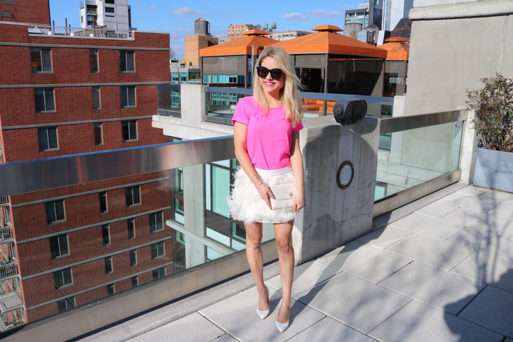 Caitlin Hartley of Styled American fashion blogger on nyc rooftop in white and pink outfit