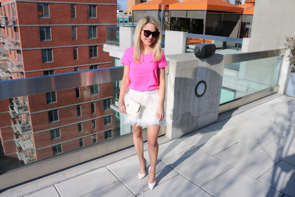 Caitlin Hartley of Styled American hot pink top, white skirt, tory burch clutch and white heels