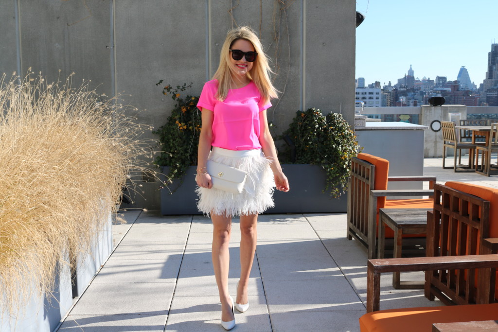 Caitlin Hartley of Styled American bright pink top, white fluffy skirt