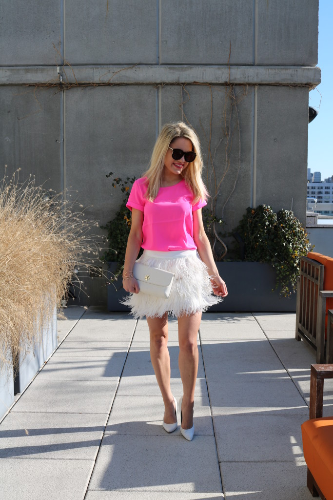 Caitlin Hartley of Styled American pink top, feather fringe white skirt and white pumps