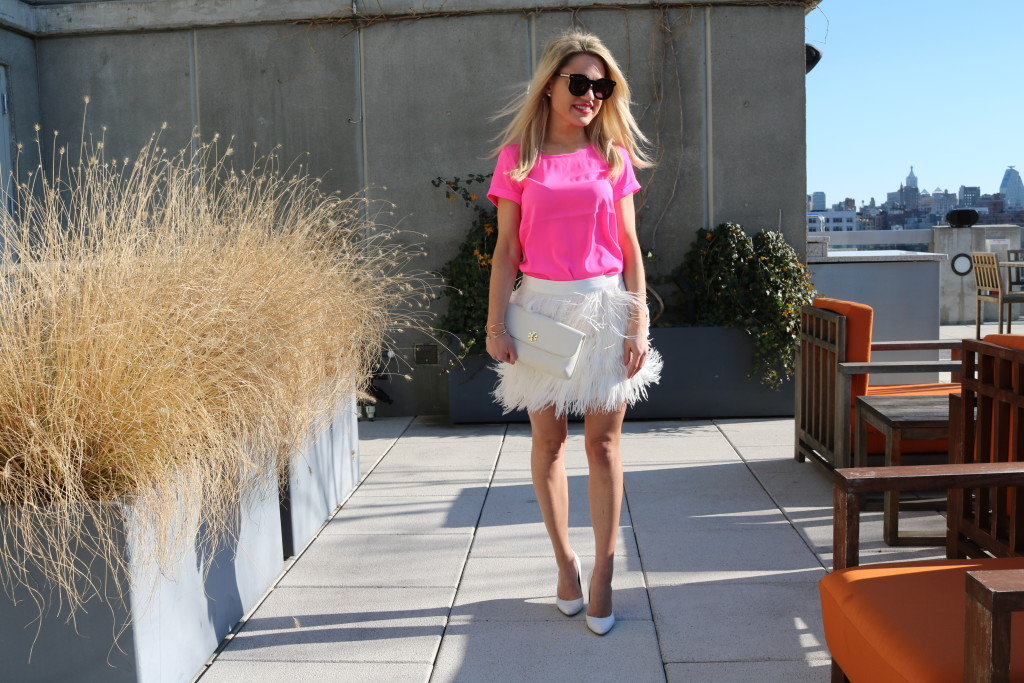 Caitlin Hartley of Styled American girls skirt blowing in the wind on nyc rooftop