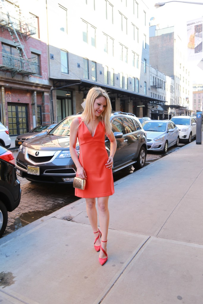 Caitlin Hartley of Styled American short red dress, red pumps, gold glitter bag