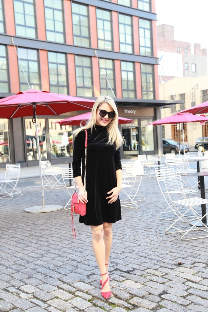 Caitlin Hartley of Styled American black velvet dress, red strapy pumps