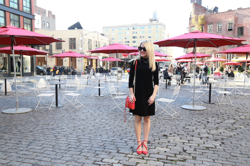 Caitlin Hartley of Styled American velvet dress with high neck and strapy red heels