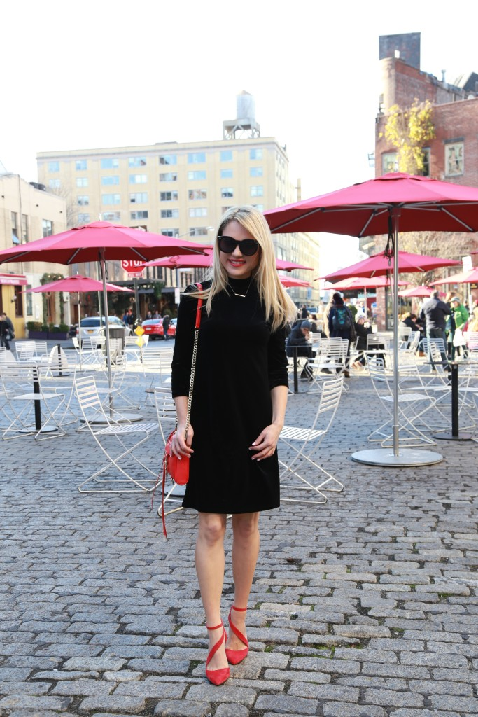 Caitlin Hartley of Styled American velvet dress and a pop of red