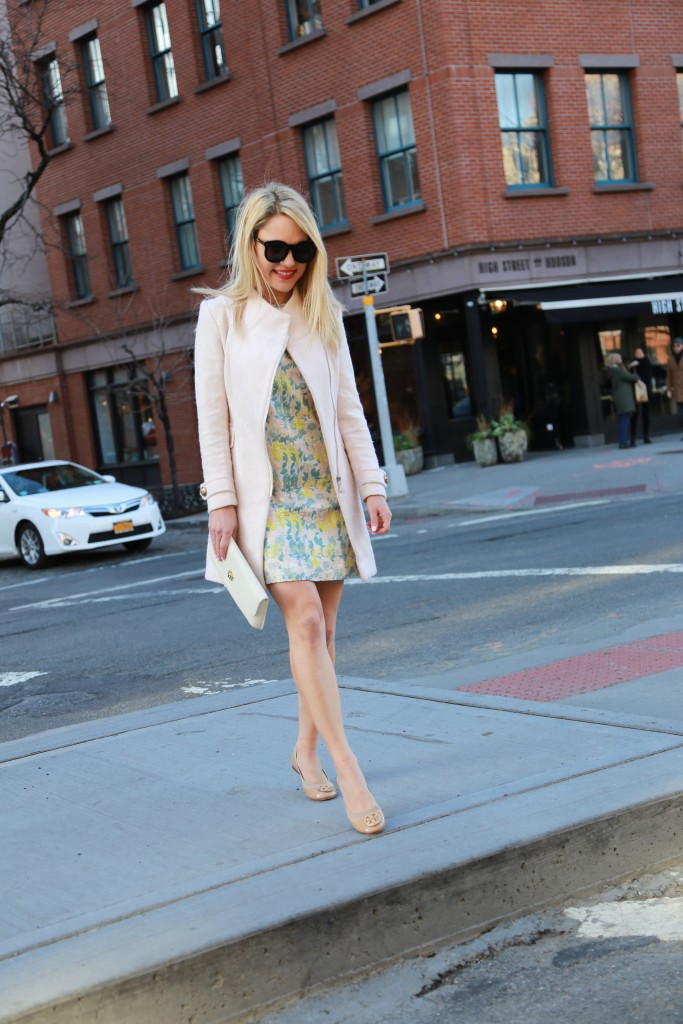 Caitlin Hartley of Styled American floral short dress, pink coat, nude flats