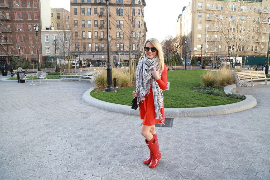 Caitlin Hartley of Styled American plaid blanket scarf with red dress and red boots