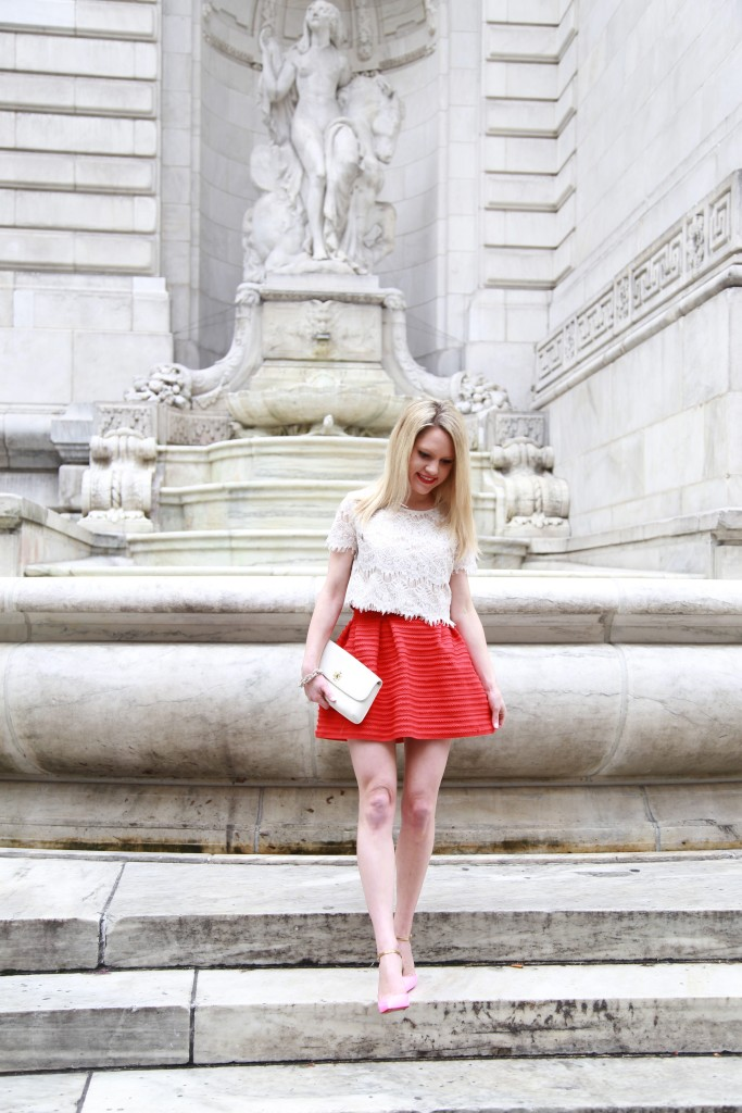 Caitlin Hartley of Styled American red skirt, lace crop top, tory burch clutch
