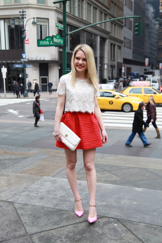 Caitlin Hartley of Styled American walking on fifth avenue with taxi's in the backdrop