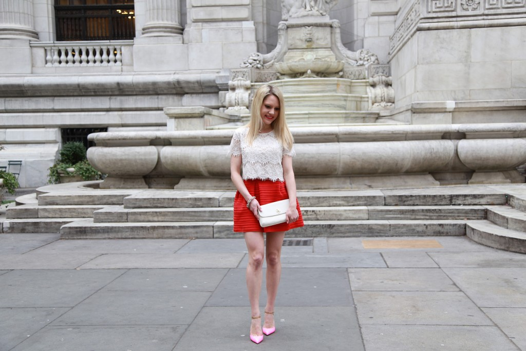 Caitlin Hartley of Styled American white tory burch clutch, red full skirt, pink christian louboutin heels