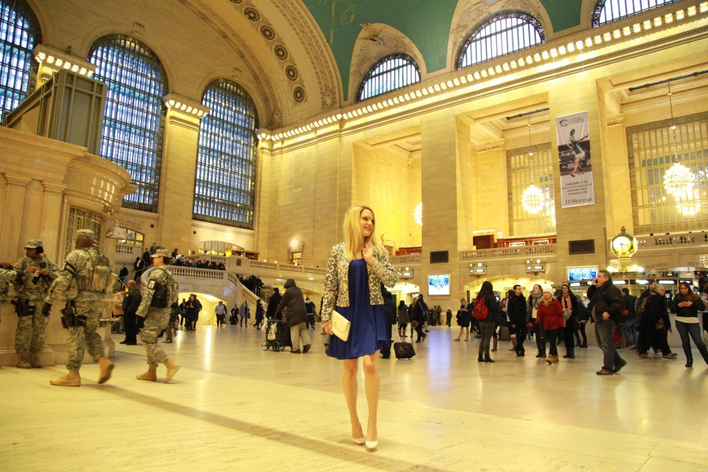 Caitlin Hartley of Styled American standing in the middle of grand central terminal