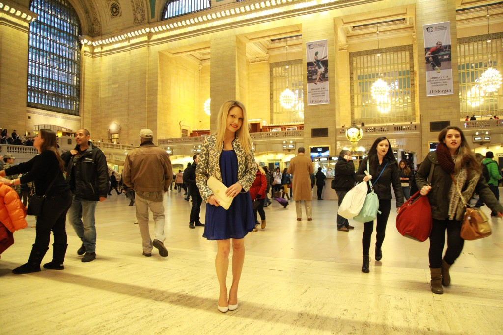 Caitlin Hartley of Styled American in grand central in aztec blazer and blue dress