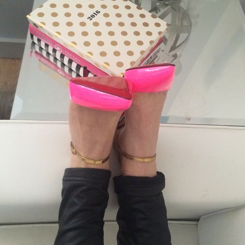 Caitlin Hartley of Styled American christian louboutin's kicked up on coffee table, kate spade notebooks
