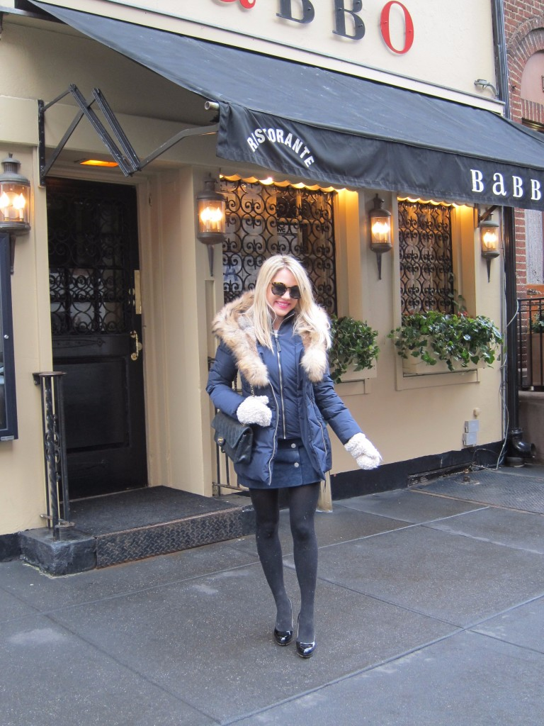 Caitlin Hartley of Styled American girl in front of Babbo in Winter attire in Greenwich Village