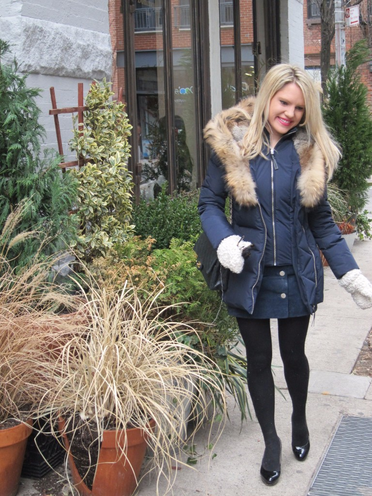 Caitlin Hartley of Styled American girl in blue Mackage coat