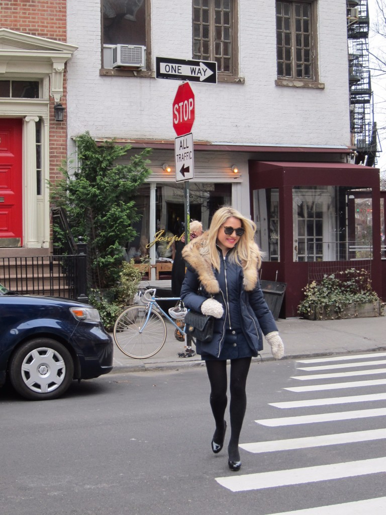 Caitlin Hartley of Styled American girl walking in the west village in front of Joseph Leonard