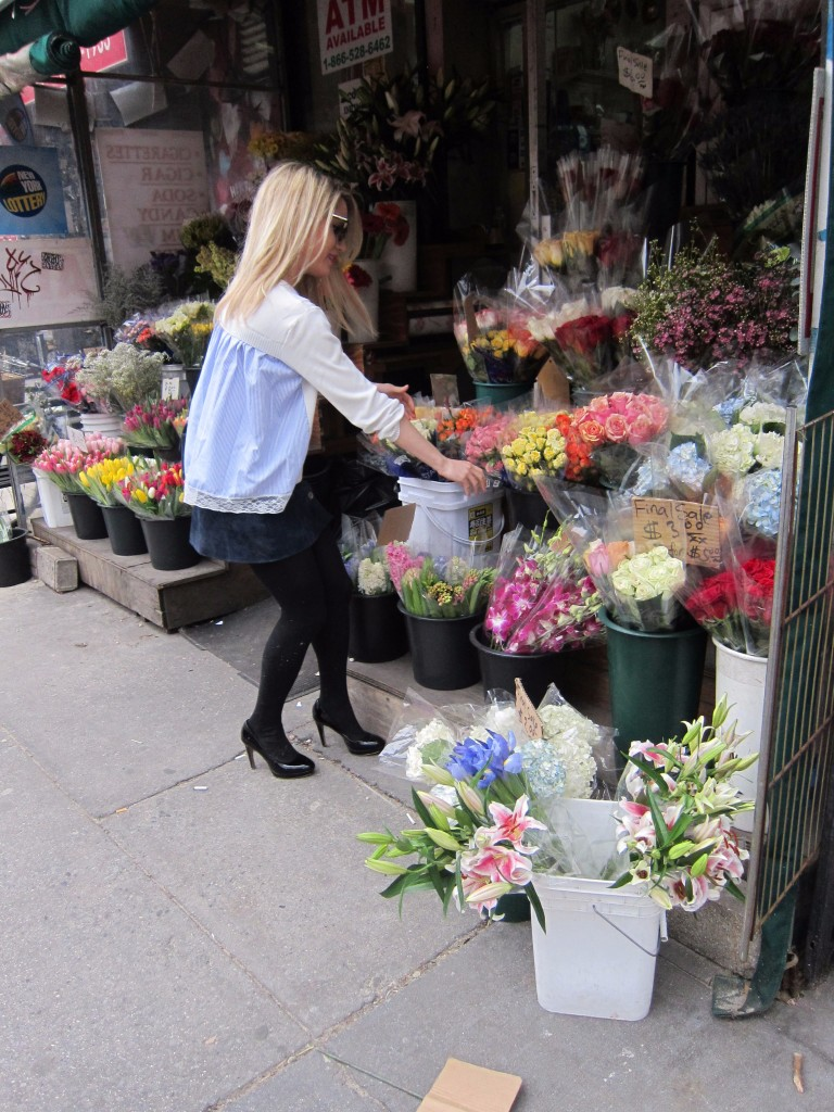 Caitlin Hartley of Styled American top with party in the back, girl picking flowers at a new york city flower stand