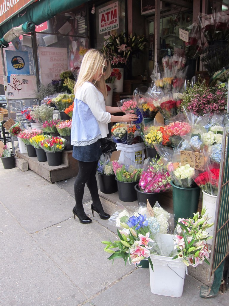 Caitlin Hartley of Styled American girl picking out flowers