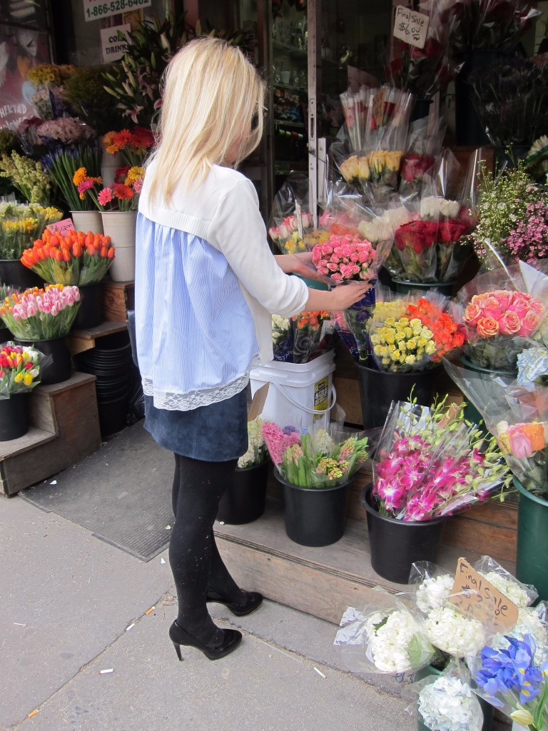 Caitlin Hartley of Styled American girl picking out NYC street flowers