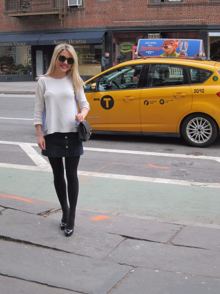 Caitlin Hartley of Styled American style blogger in front of taxi