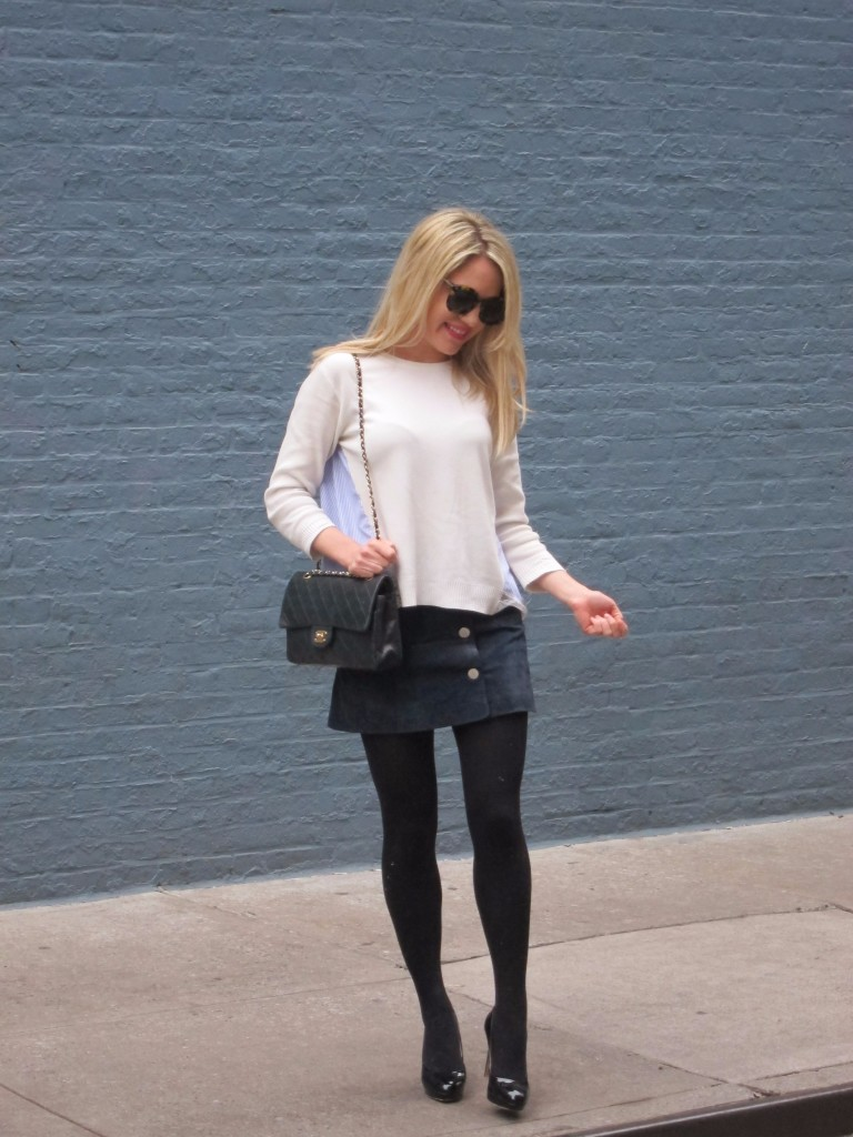 Caitlin Hartley of Styled American spring style against blue wall