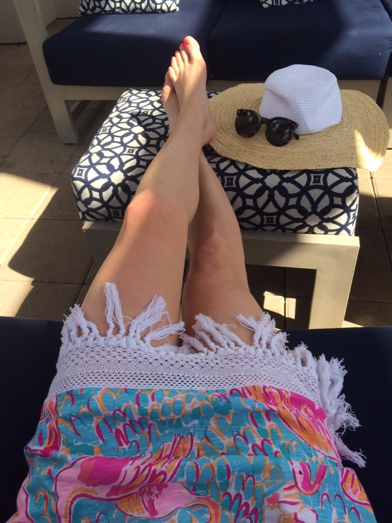 Caitlin Hartley of Styled American fashion blogger in Lilly Pulitzer pool cover-up, lounging under cabana