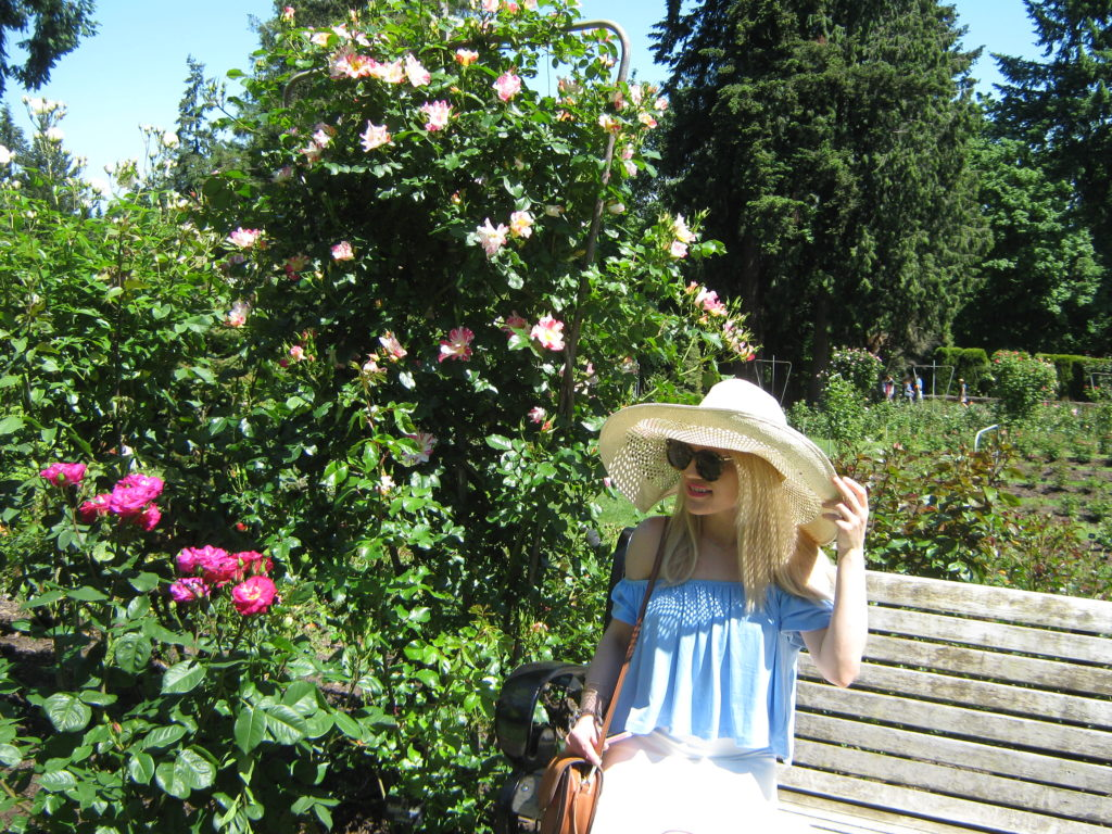 Caitlin-Hartley-of-Styled-American-rose-garden-floppy-sun-hat-sunglasses-off-the-shoulder-top-brown-bag