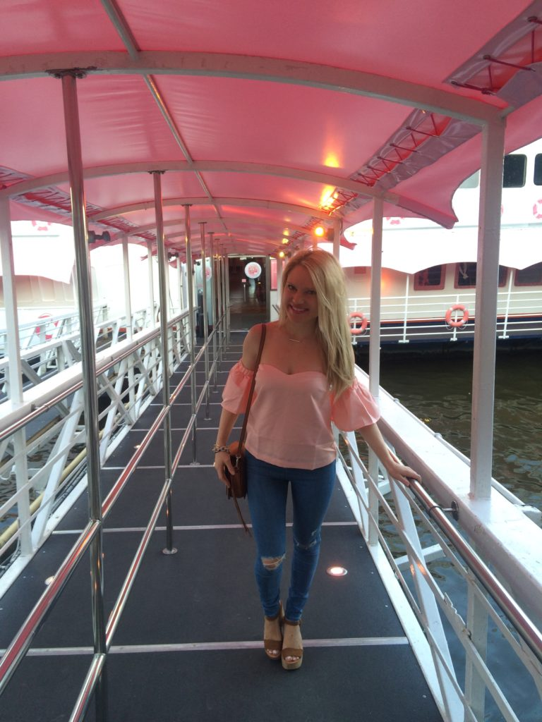 Caitlin-of-Styled-American-pink-off-the-shoulder-top-skinny-jeans-on-pink-boat
