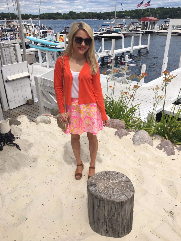Caitlin-Hartley-of-Styled-American-at-lake-geneva-in-lilly-pulitzer-skirt-and-red-cardigan
