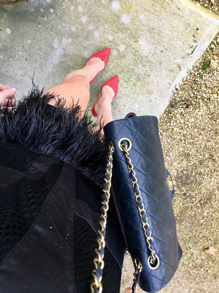 black-feather-dress-red-pumps-black-chanel-bag-from-above http://styledamerican.com/cocktail-dress-with-feather-hem/