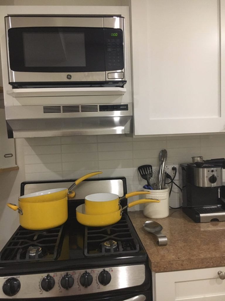 yellow-cookware http://styledamerican.com/my-kitchen/