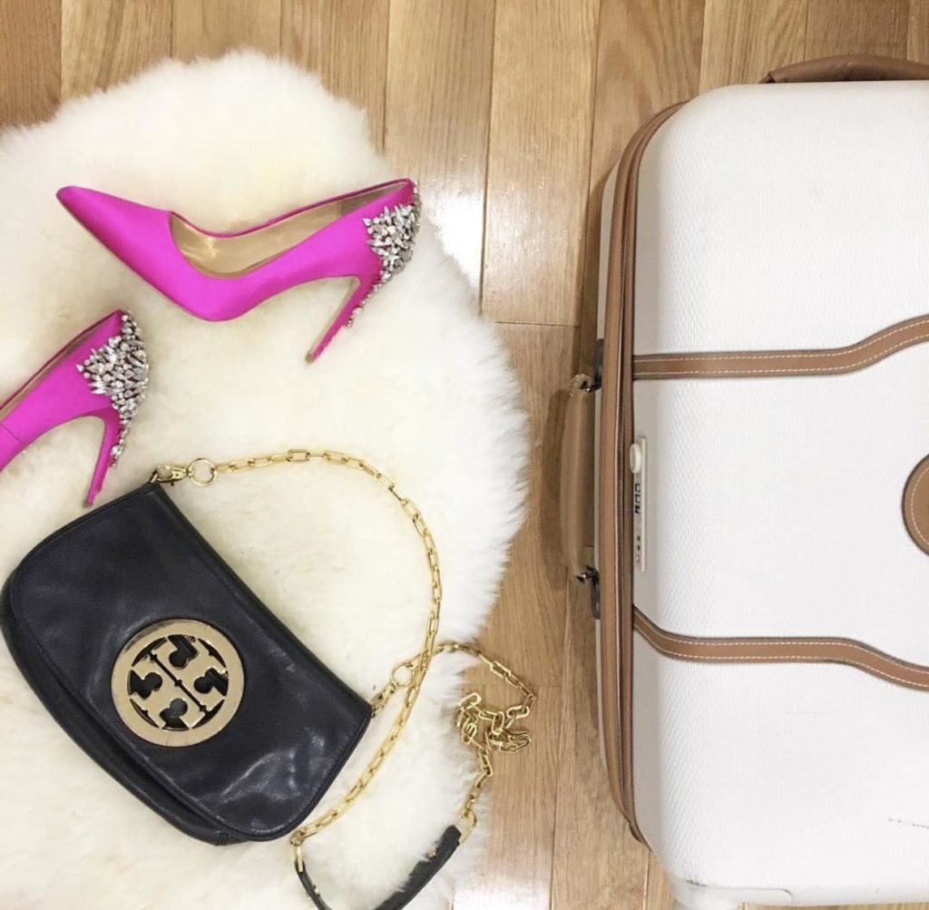 flatly of a suitcase and pink heels  http://styledamerican.com/instagram-roundup-summer-adventures/